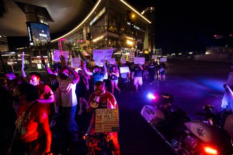 People march along Las Vegas Boulevard in memory of Jorge Gomez and other victims of police vio ...