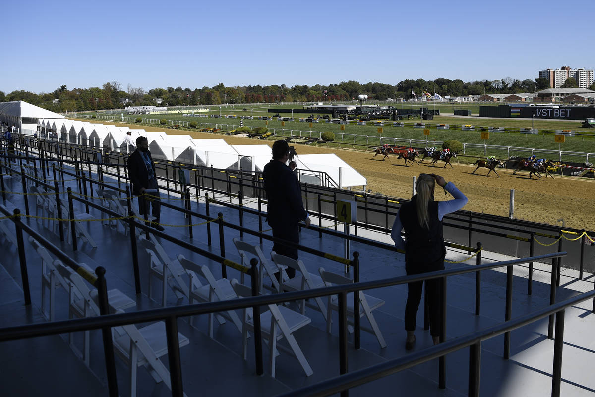 Fans watch the fifth race ahead of the 145th Preakness horse race at Pimlico race course, Satur ...