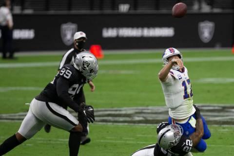 Buffalo Bills quarterback Josh Allen (17) throws as Las Vegas Raiders cornerback Keisean Nixon ...
