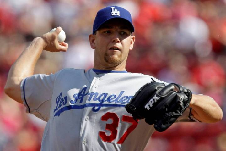 Los Angeles Dodgers pitcher Charlie Haeger throws to a Cincinnati Reds batter during a baseball ...
