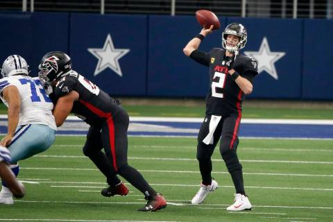 Dallas Cowboys defensive tackle Trysten Hill (72) rushes as Atlanta Falcons offensive guard Chr ...