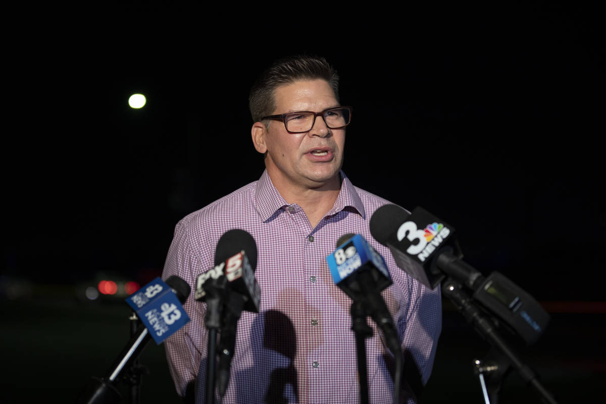 Lt. David Valenta of Metro's Special Victims Unit briefs the media at the scene of the investig ...