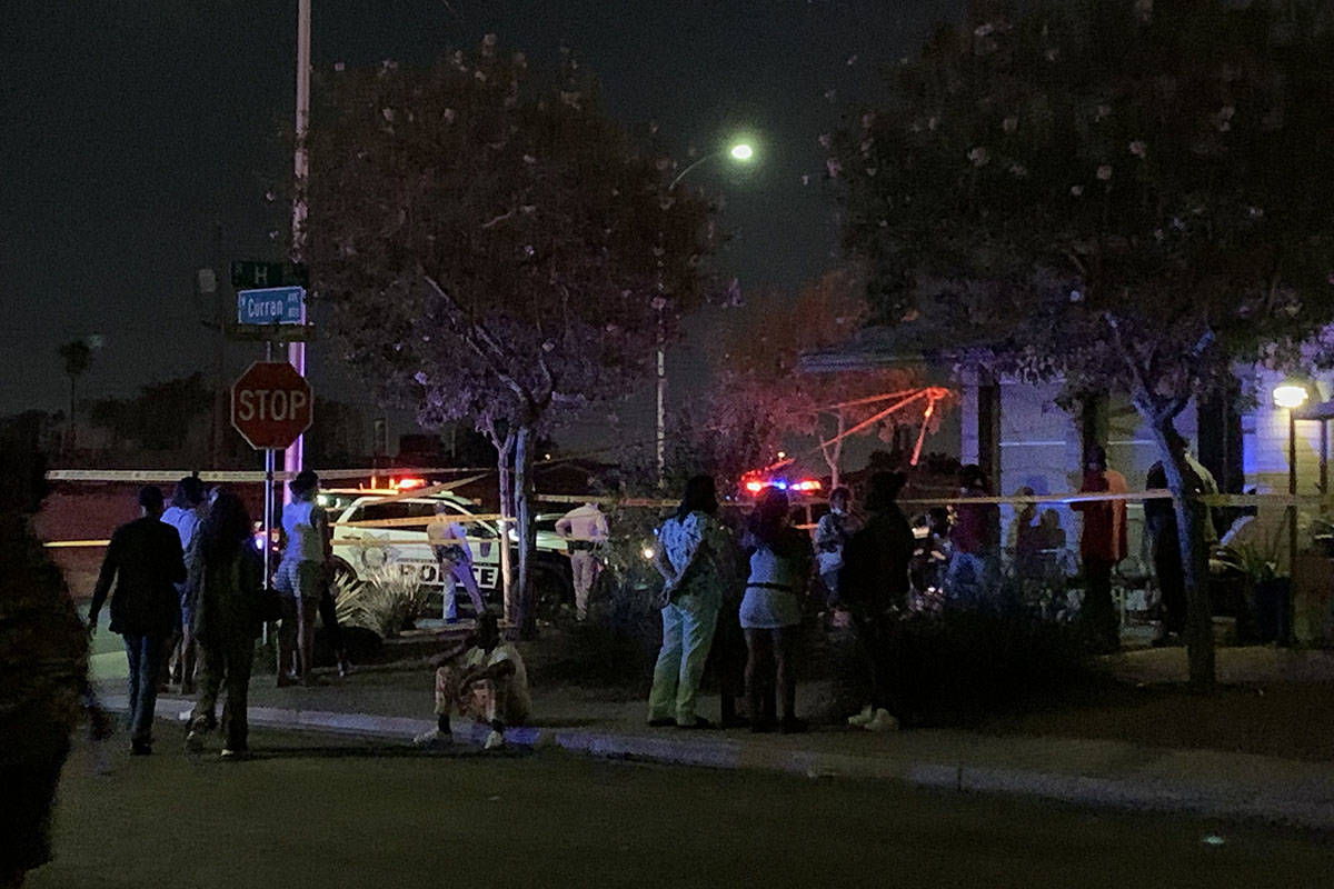 People gather after the discovery of a dead child Monday, Oct. 5, 2020, on the 1700 block of H ...