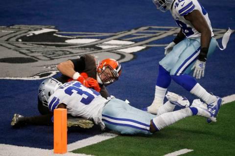 Dallas Cowboys safety Donovan Wilson (37) and linebacker Joe Thomas (48) defend as Cleveland Br ...