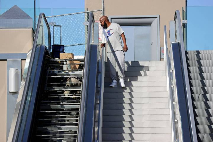 Juante Longmire of Muskegon, Mich. checks out an escalator closed for maintenance at the pedest ...