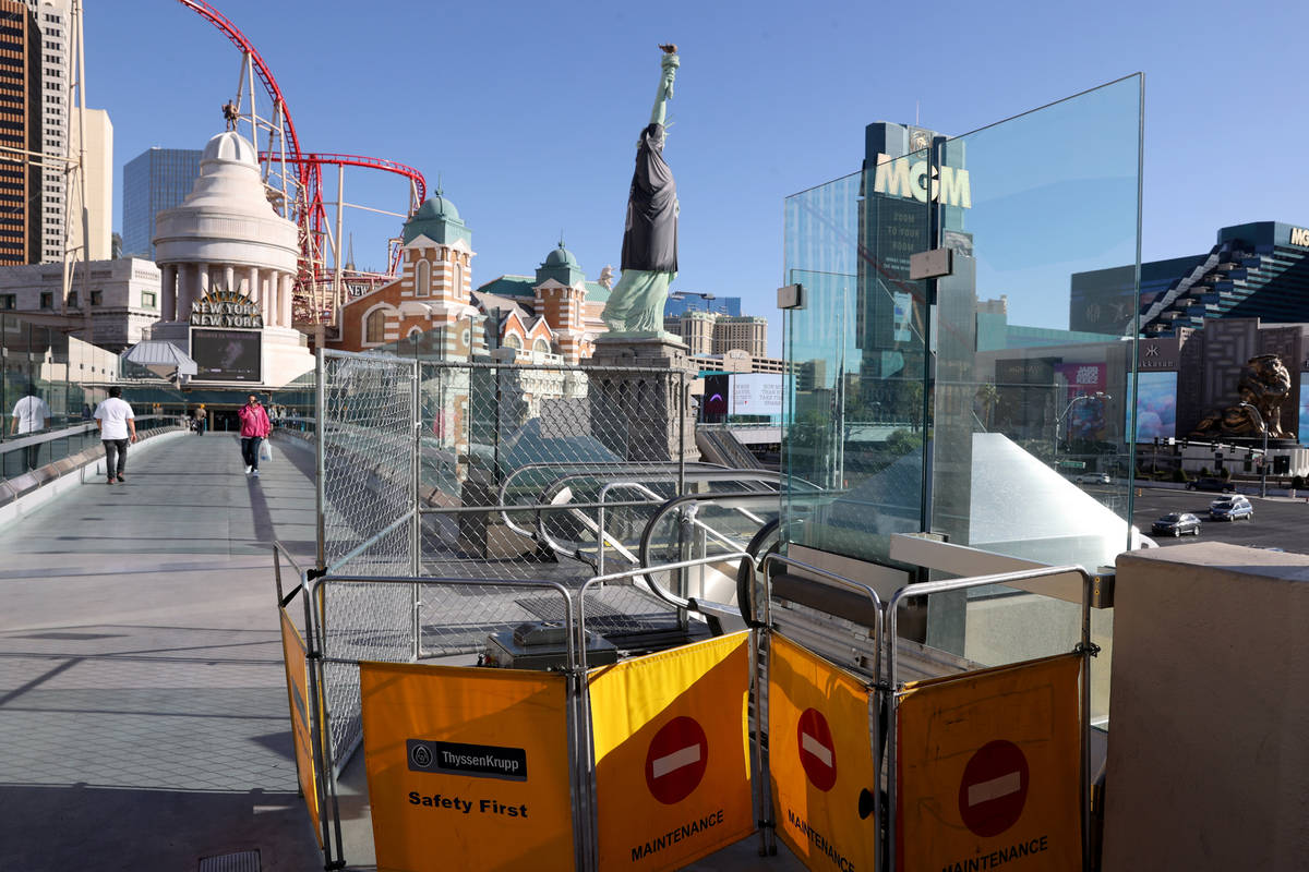 An escalator is closed for scheduled maintenance at the pedestrian bridge between Excalibur and ...