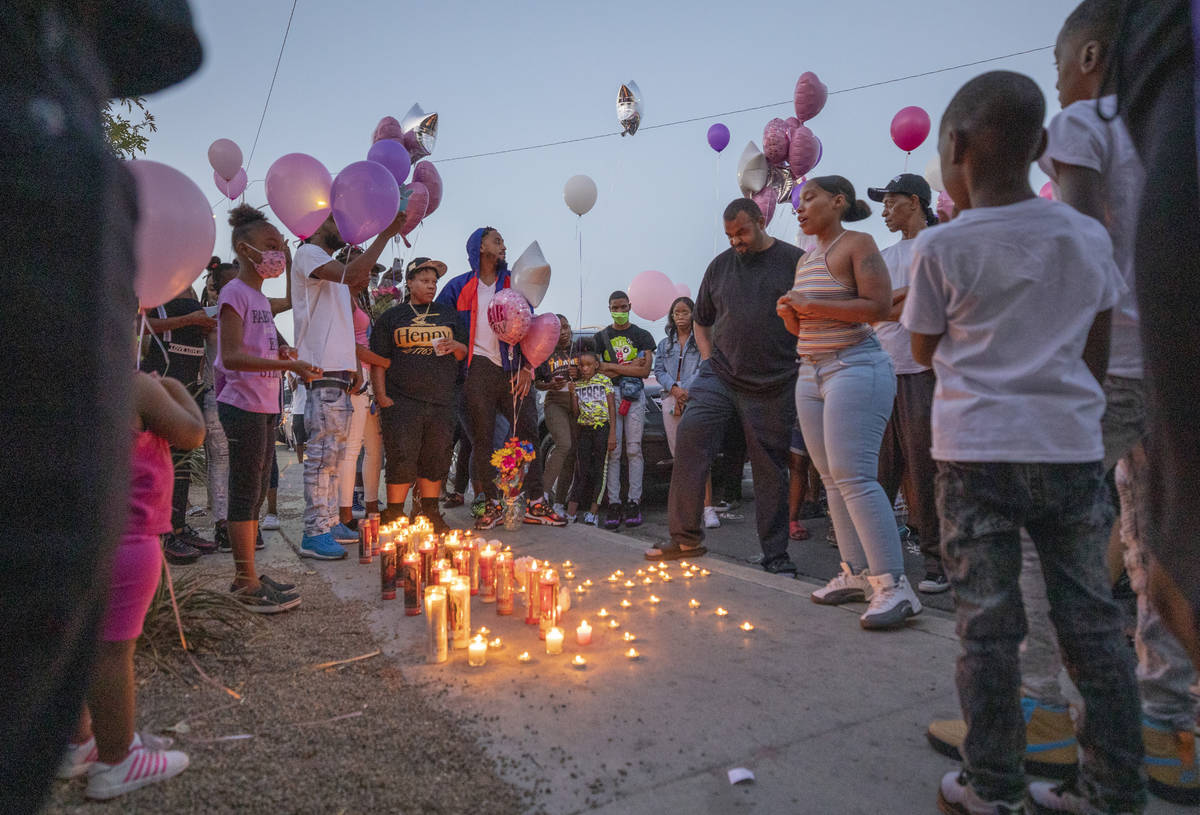 Family and friends mourn the death of 1-year, 9-month-old Sayah Deal, outside of 1719 H St. in ...