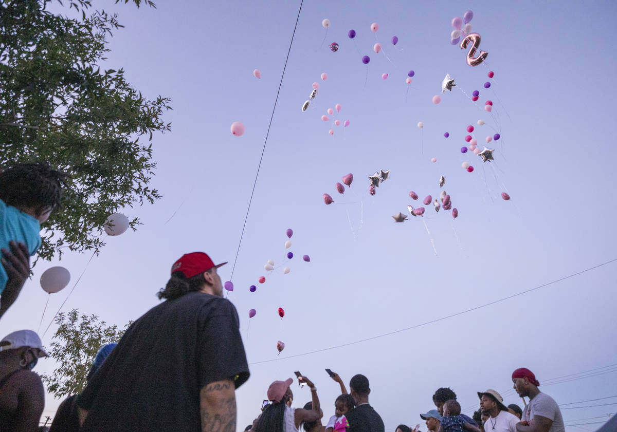 Family and friends let go of balloons during a memorial for the death of 1-year, 9-month-old Sa ...