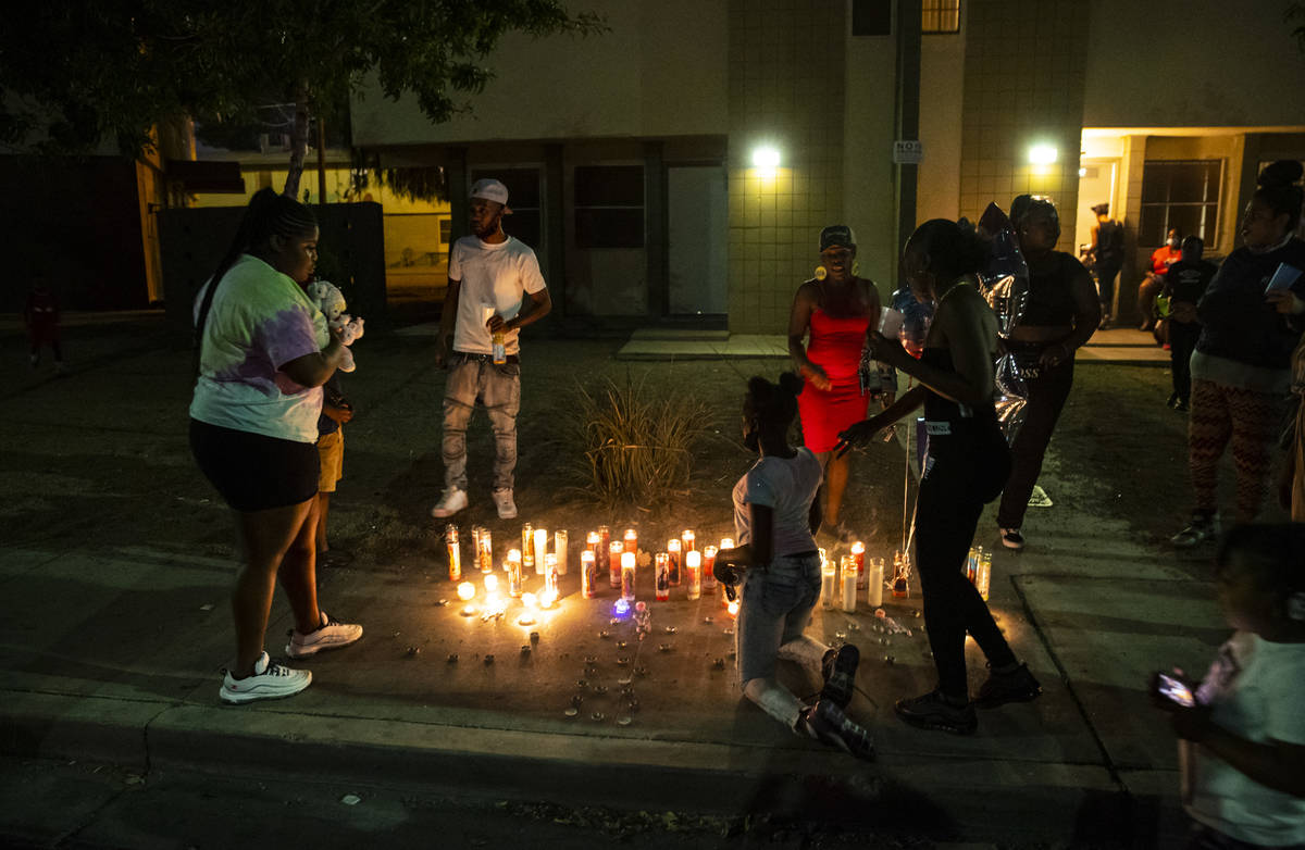 People gather by candles lit in memory of 1-year-old Sayah Deal in Las Vegas on Tuesday, Oct. 6 ...