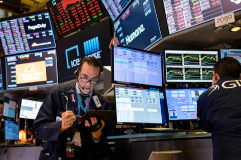 In this March 16, 2020, file photo, trader Gregory Rowe works on the floor of the New York Stoc ...