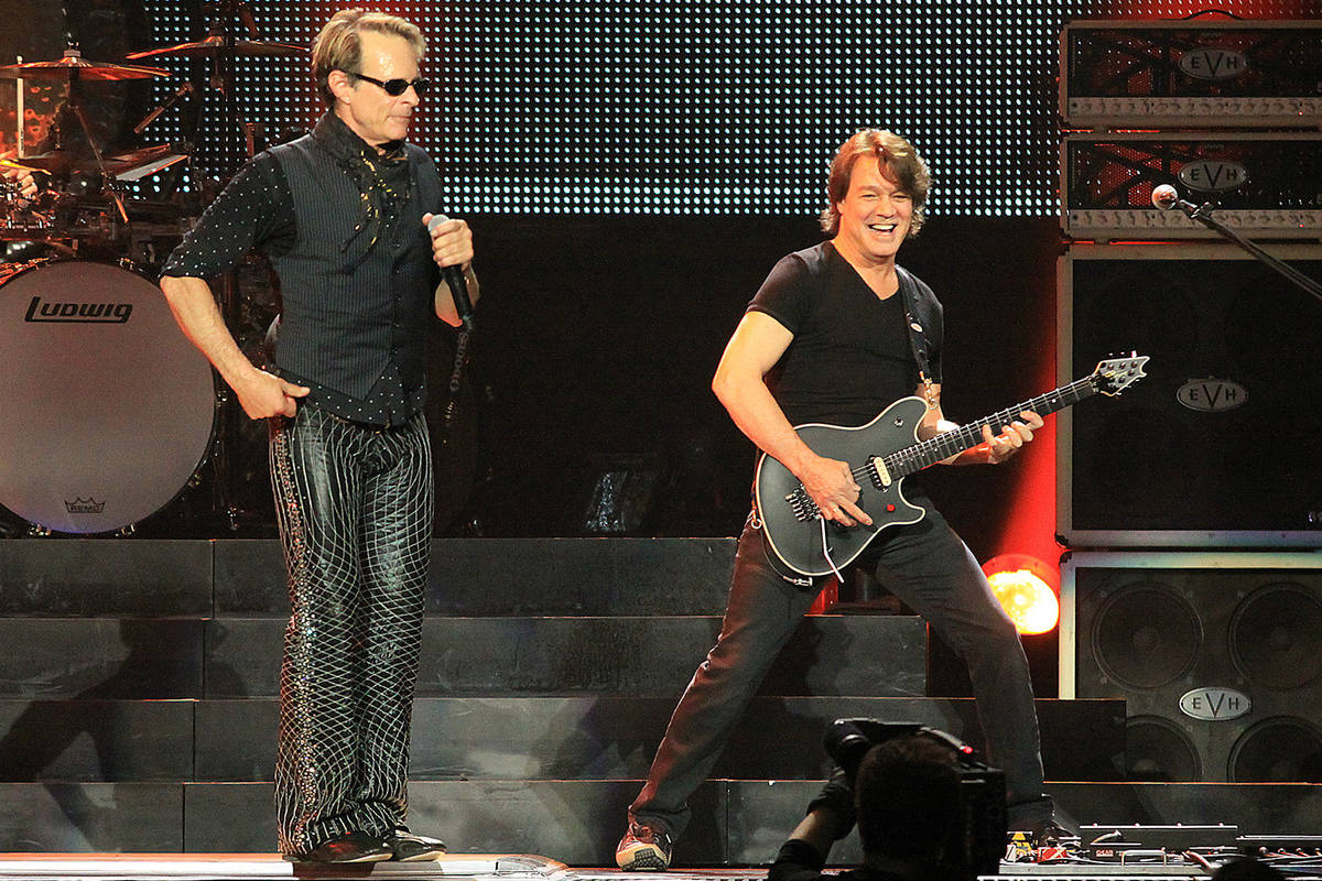 Eddie Van Halen, right, performs with lead singer David Lee Roth, and the band Van Halen live a ...