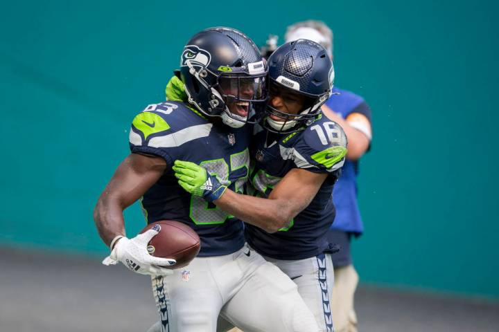 Seattle Seahawks wide receiver David Moore (83) scores a touchdown against the Miami Dolphins a ...