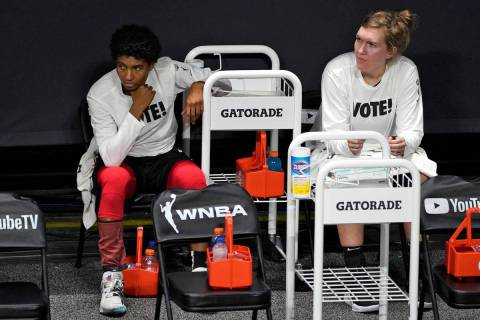 Las Vegas Aces forward Angel McCoughtry, left, and center Carolyn Swords react on the bench aft ...