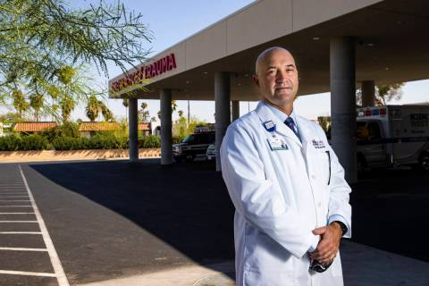 Dr. Robert Smith, associate chief medical officer for Sunrise Hospital, poses for a portrait in ...