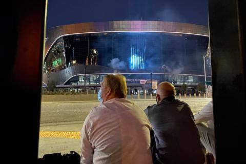 Raiders owner Mark Davi, left, and team president Marc Badain sit outside Allegiant Stadium on ...