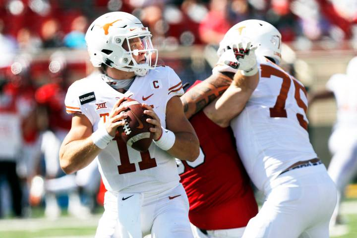 In this Saturday Sept. 26, 2020, file photo, Texas quarterback Sam Ehlinger looks for an open r ...