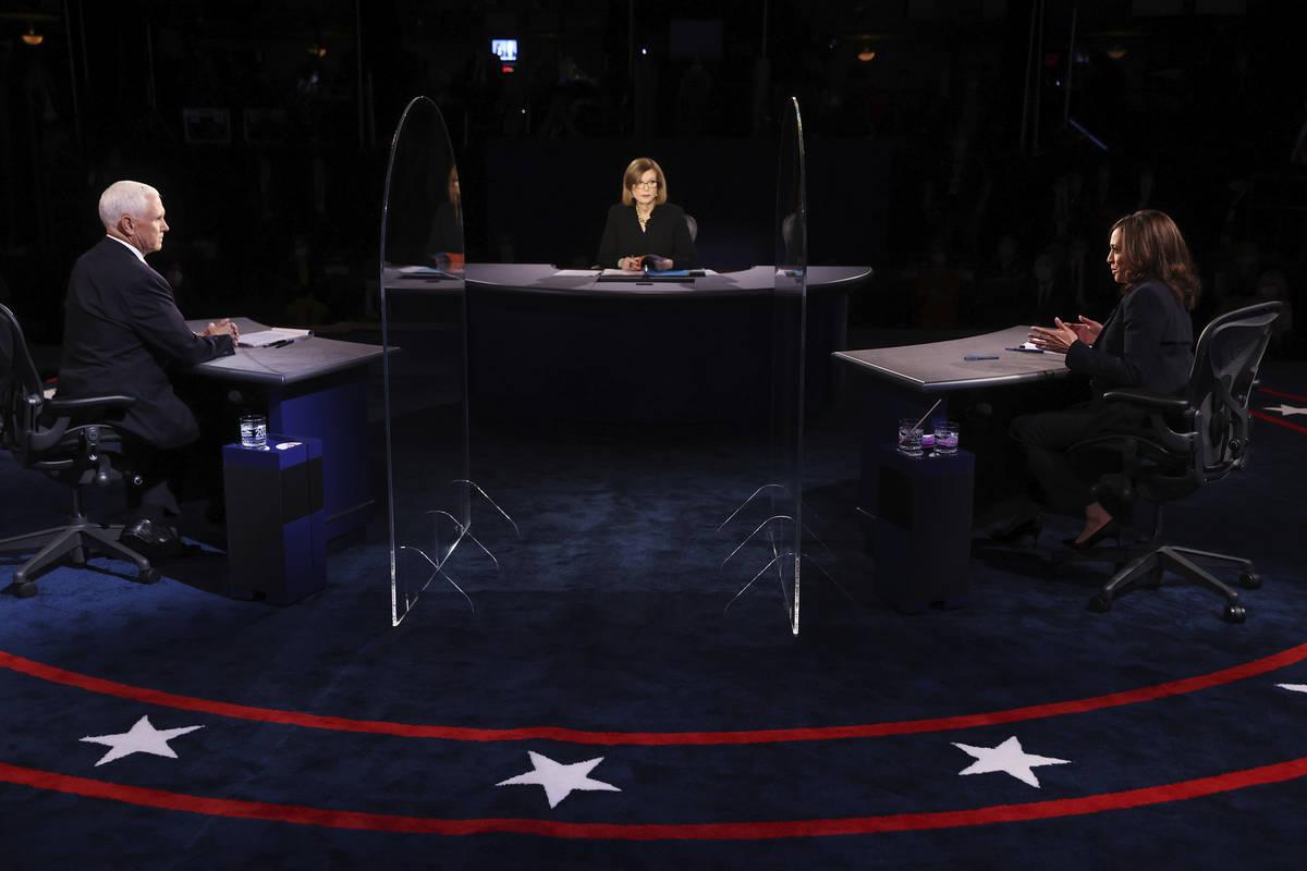 Vice President Mike Pence listens as Democratic vice presidential candidate Sen. Kamala Harris, ...