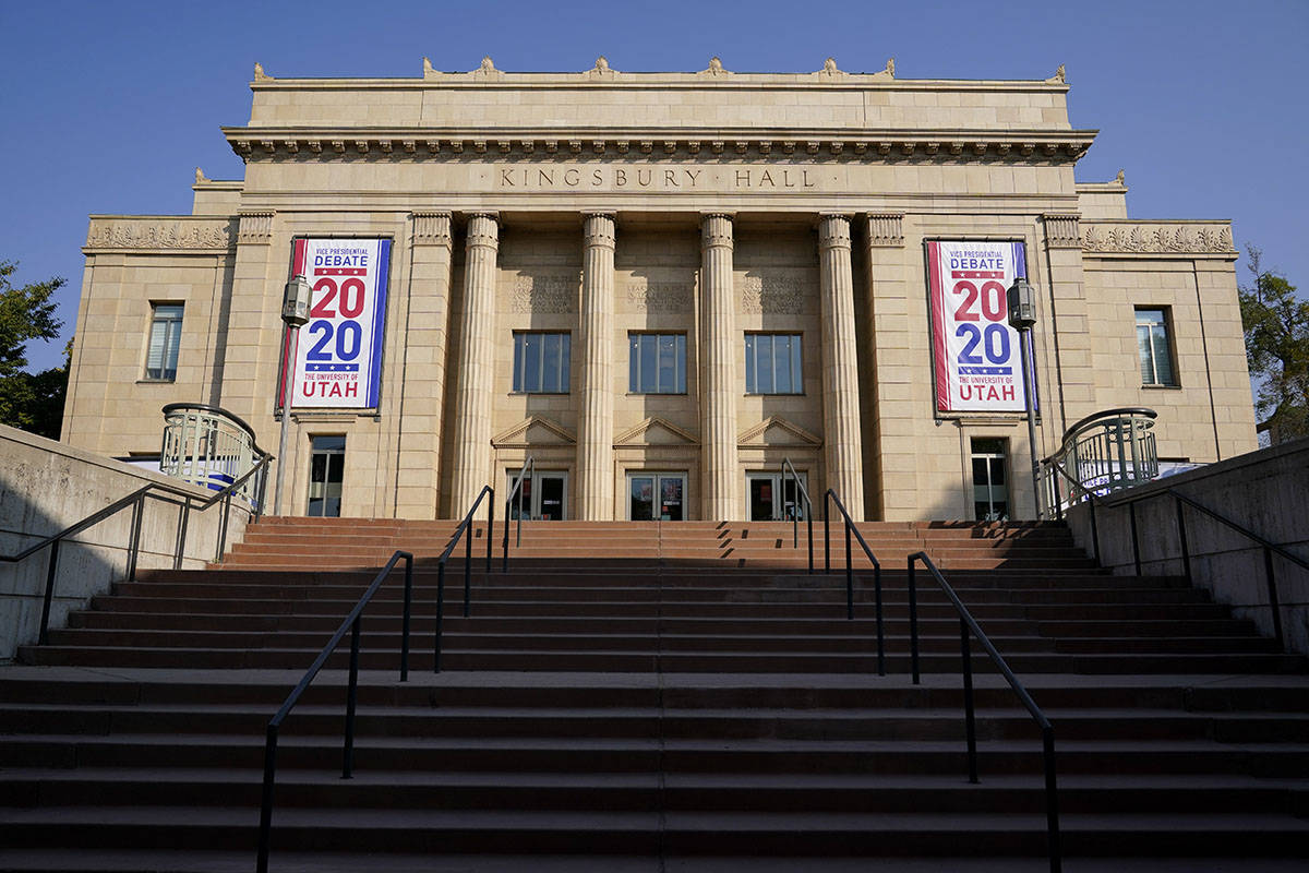 Banners hang from Kingsbury Hall at the University of Utah as preparations take place for the v ...