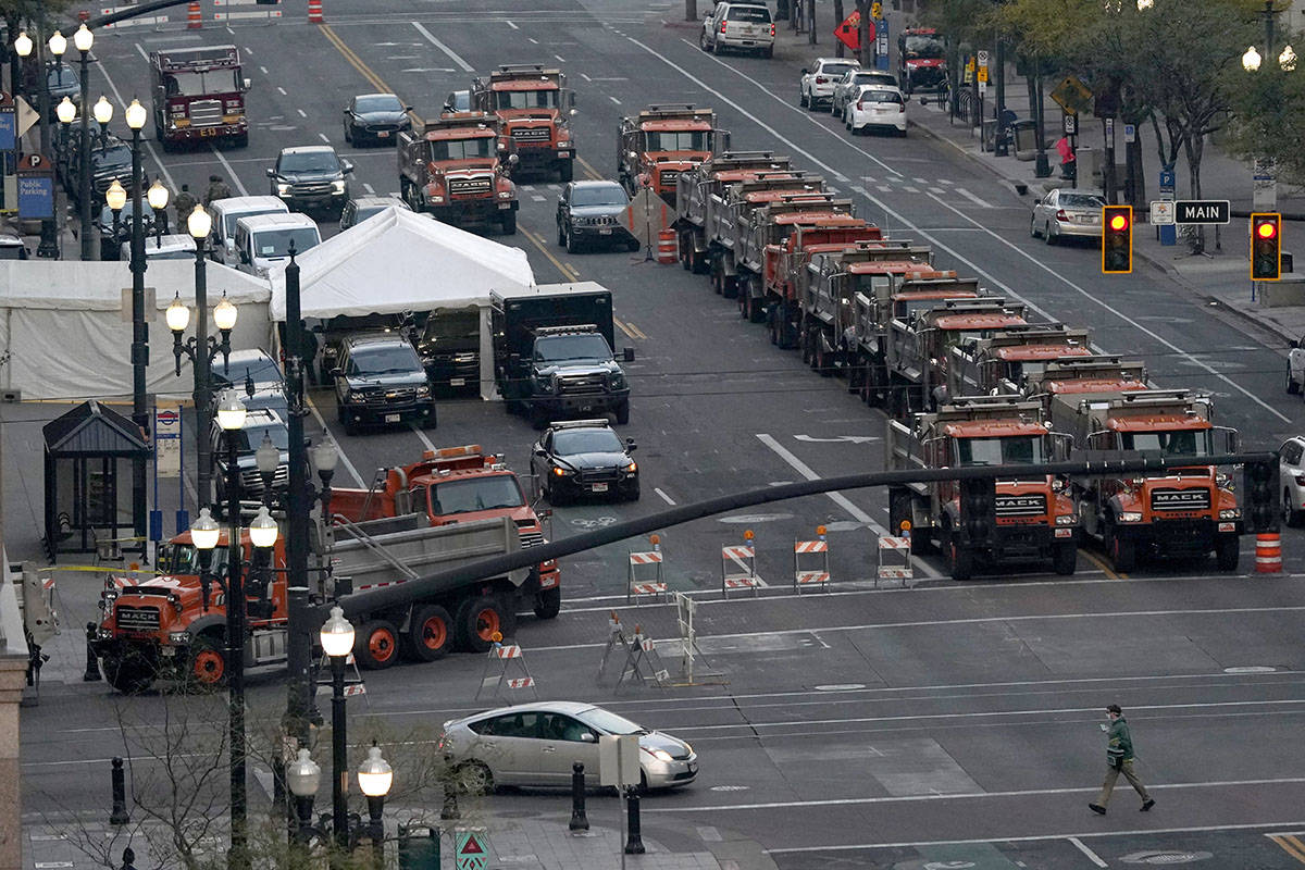 A perimeter is set by heavy dump trucks around a hotel in downtown Salt Lake City, the site of ...