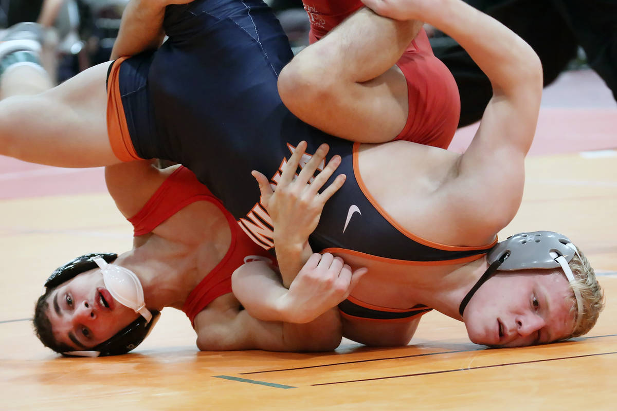 Cornell University's Michael Russo, left, and, Louie Hayes of Virginia wrestle during the 36th ...