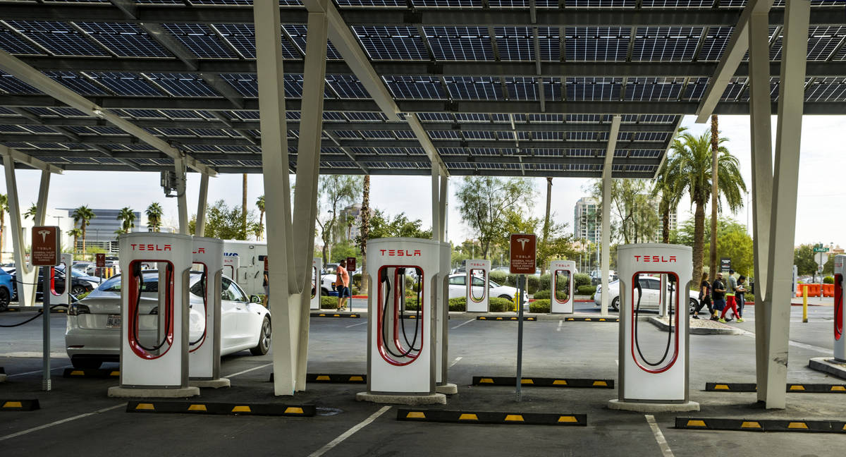 Several cars plug in at the Tesla Supercharger station near The Linq and High Roller on Friday, ...