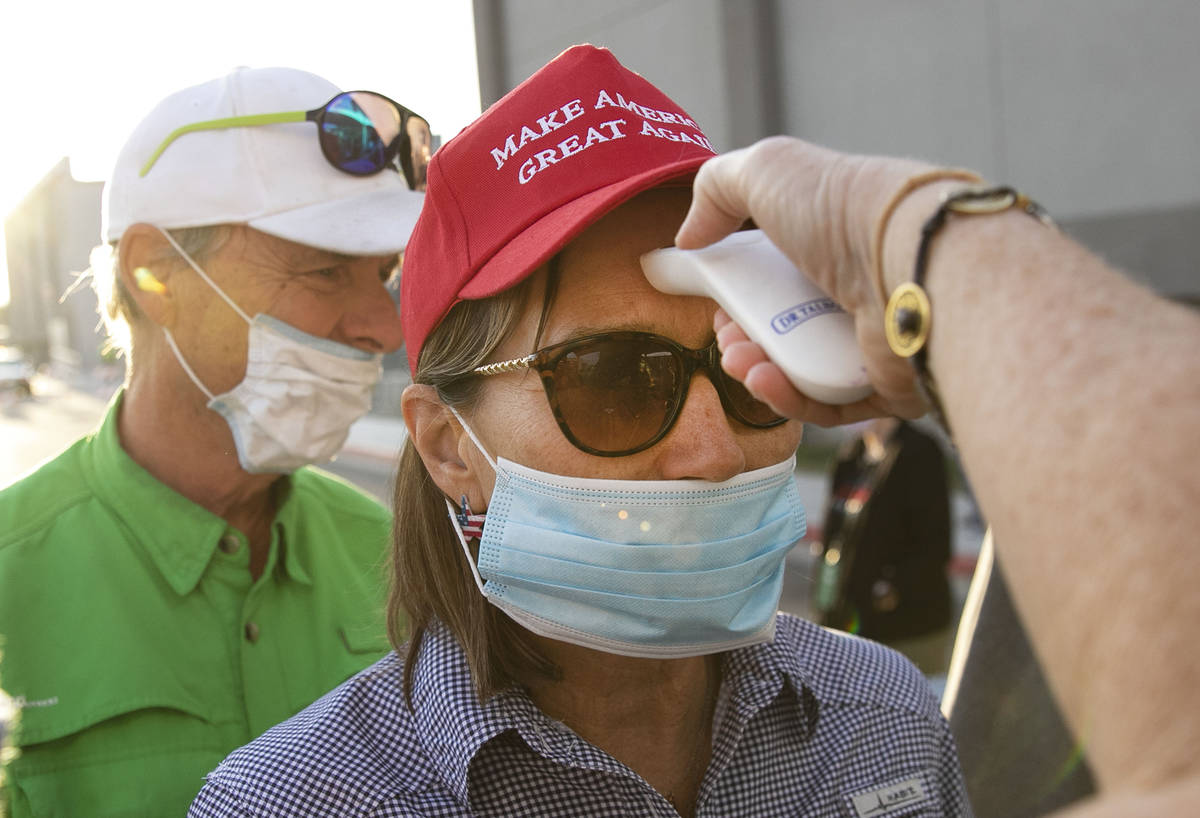 Make America Great Again event attendees get their temperature checked at Boulder City Airport ...