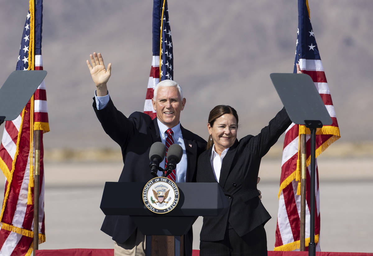 Vice President Mike Pence and his wife Karen wave to the crowd during Make America Great Again ...