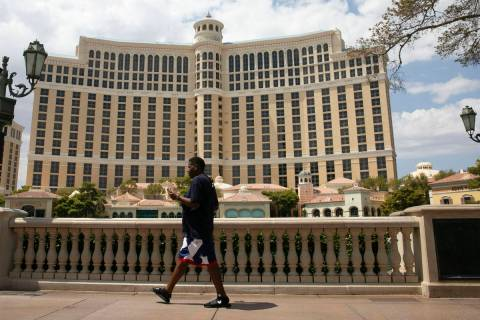 Pedestrian walk past the Bellagio on Friday, Aug. 28, 2020, in Las Vegas. Thousands of MGM Reso ...