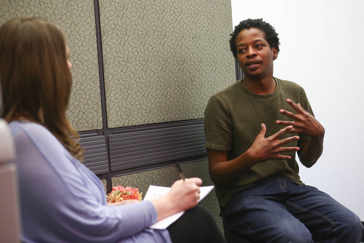Jermaine Dillard Jr., right, is interviewed by Sitel Group coach Colleen Ewing during a job fai ...
