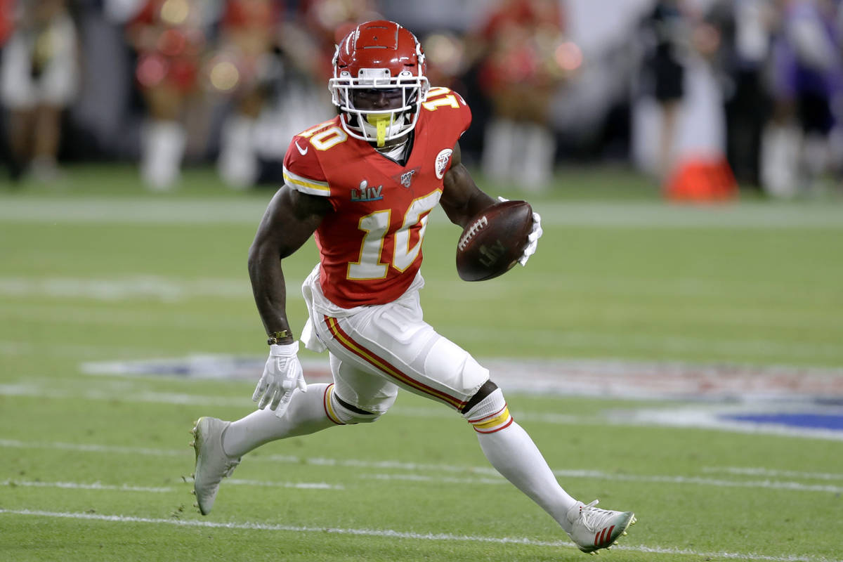 Kansas City Chiefs' Tyreek Hill runs against the San Francisco 49ers during the first half of t ...
