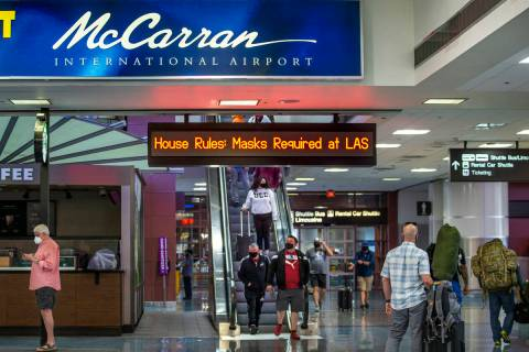 Passengers move about the Terminal 1 baggage claim area at McCarran International Airport on We ...