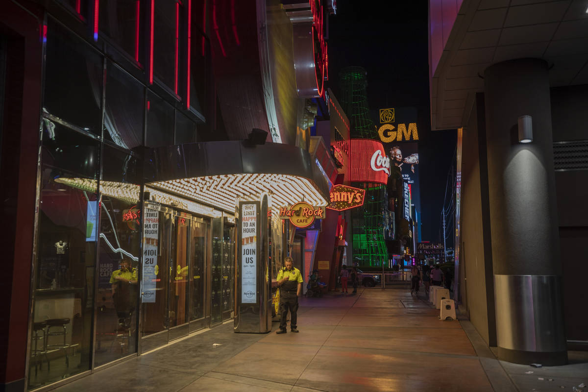 A security guard is seen outside of Hard Rock Cafe on the Las Vegas Strip, early Thursday morni ...