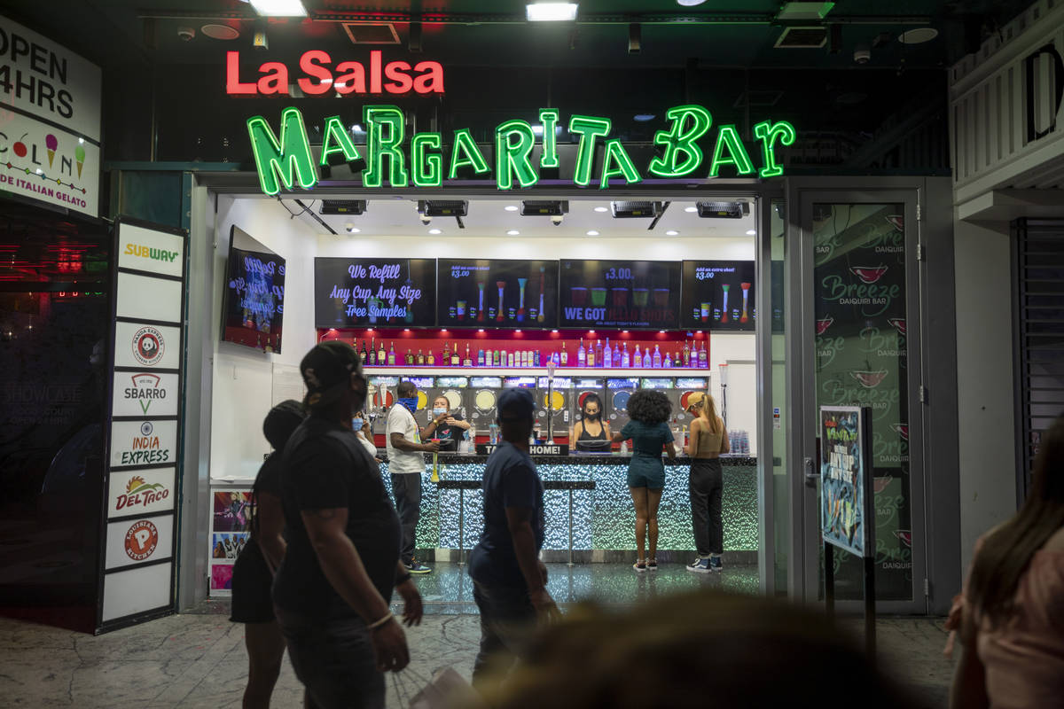 Tourists purchase drinks from La Salsa Margarita Bar on the Las Vegas Strip, early Thursday, Oc ...