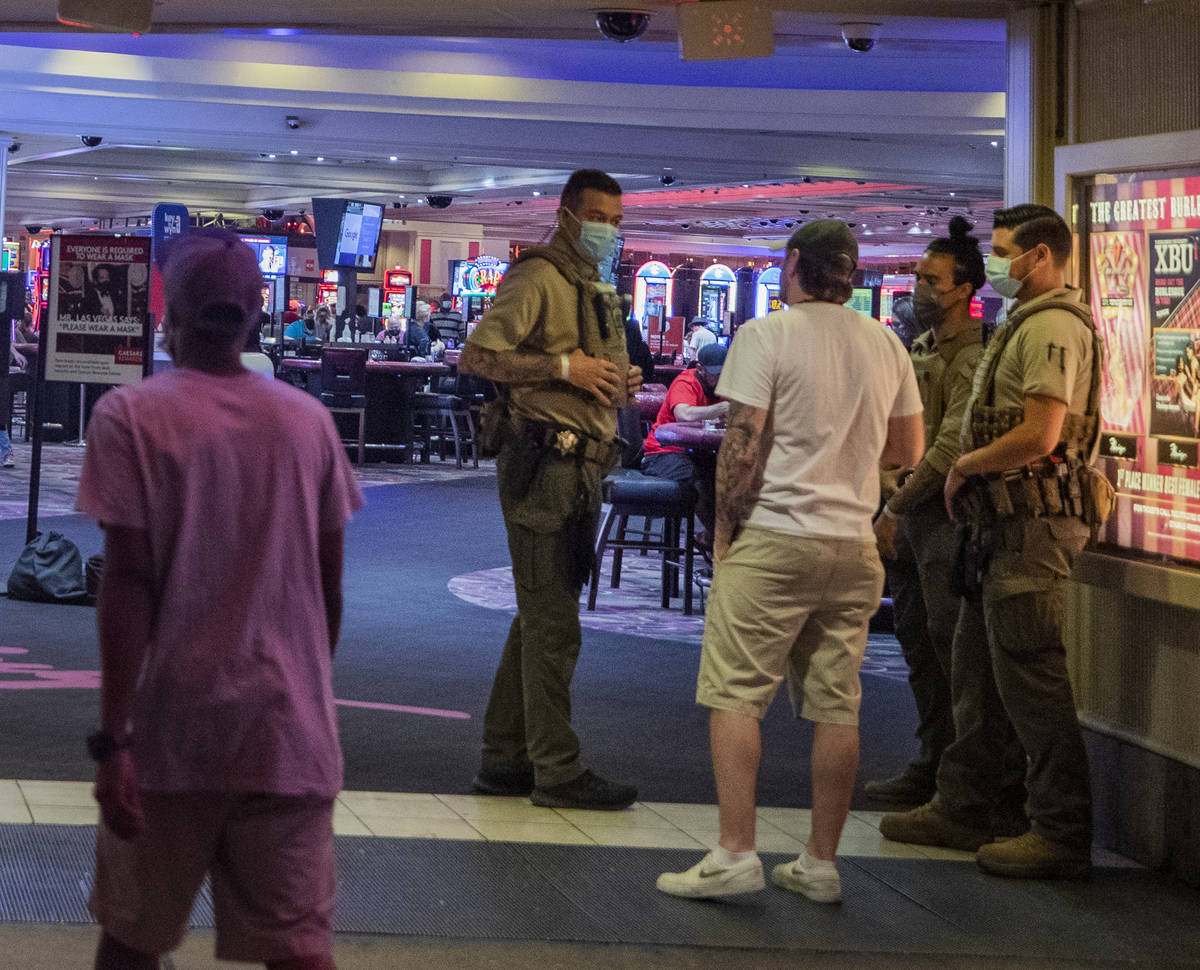 Security guards are seen at an entrance of the LINQ Hotel and Casino, on the Las Vegas Strip ea ...