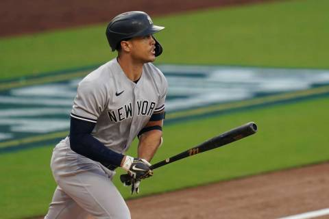 New York Yankees' Giancarlo Stanton watches his solo home run against the Tampa Bay Rays during ...