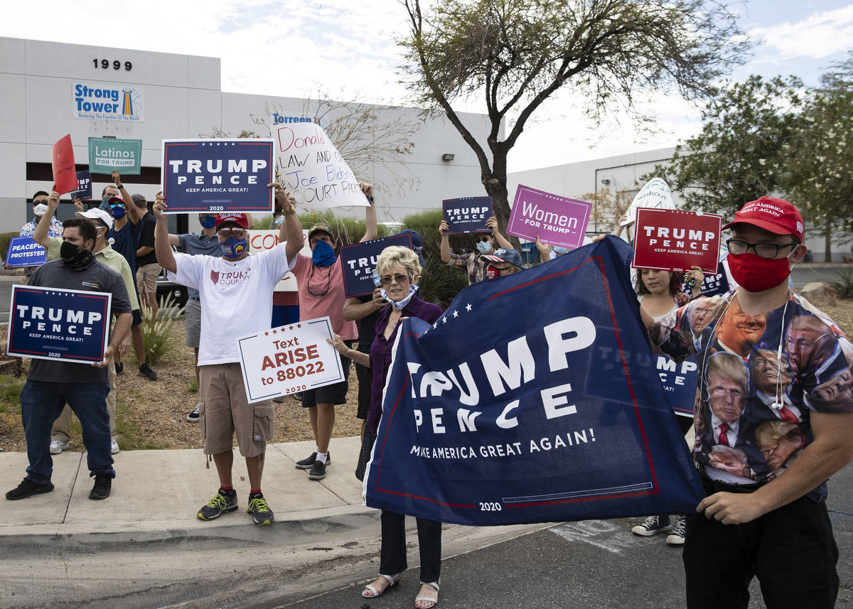 President TrumpÕs supporters, including Michael, right, who declined to give his name, and ...