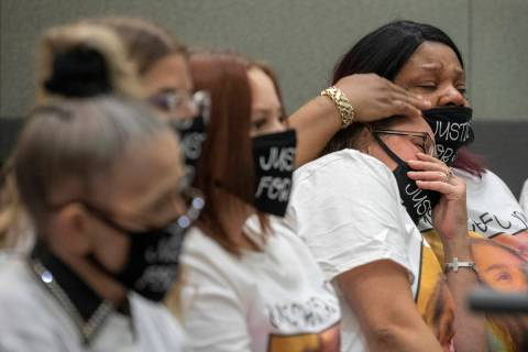 Victim Jennifer Ratay's friends Wendy Wilder, left, and Sharold McNeel, far left, listen as Chu ...