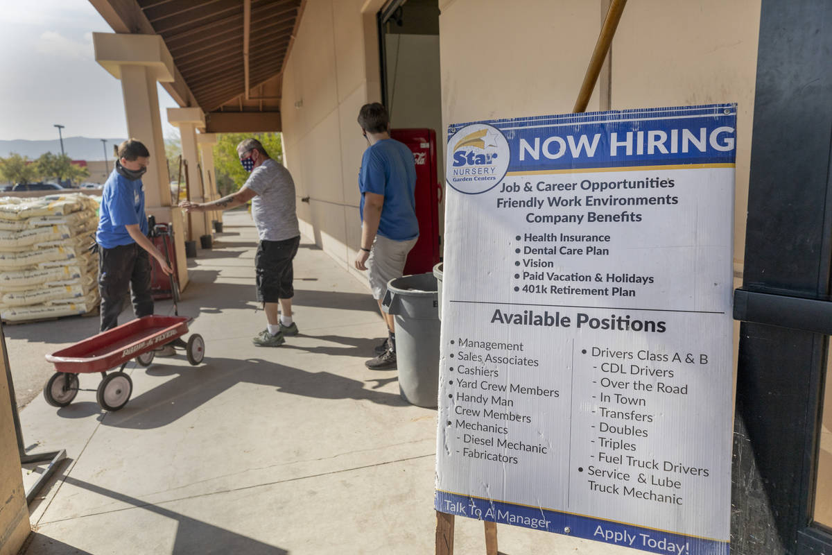 A now hiring sign is seen at the entrance of Star Nursery on W Tropicana Ave.,Thursday, Oct. 8, ...