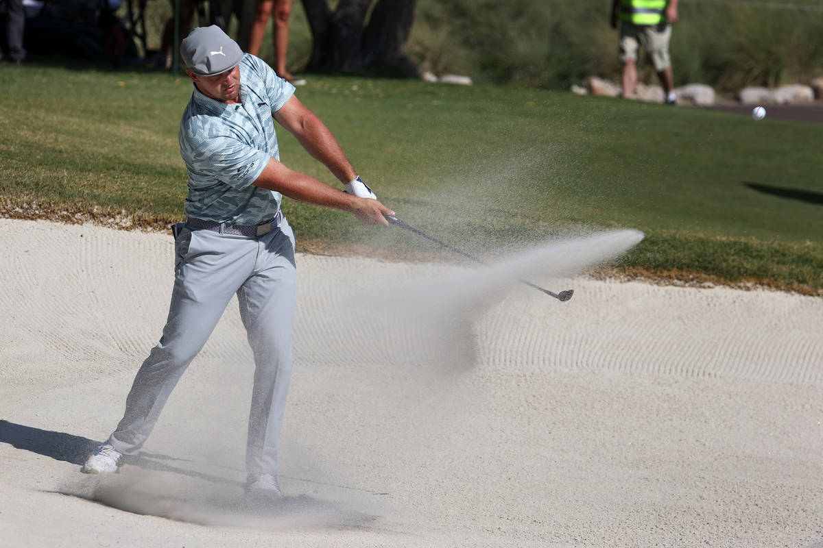 Bryson DeChambeau hits the ball from the bunker at the seventh hole during round three of the 2 ...