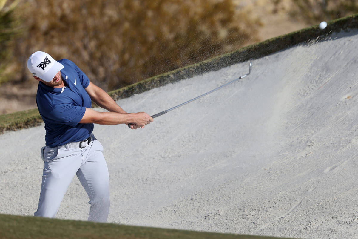 Wyndham Clark hits a bunker shot at the 15th hole during round three of the 2020 Shriners Hospi ...