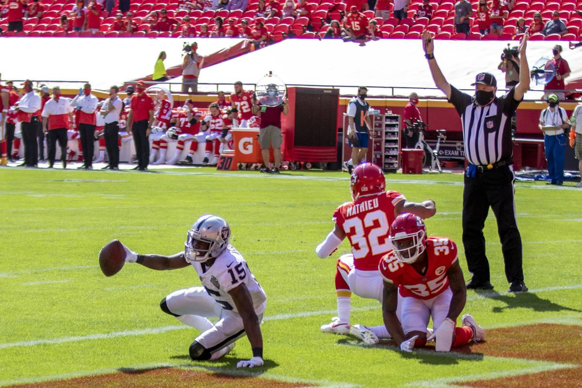 Las Vegas Raiders wide receiver Nelson Agholor (15) scores a touchdown against defenders Kansas ...