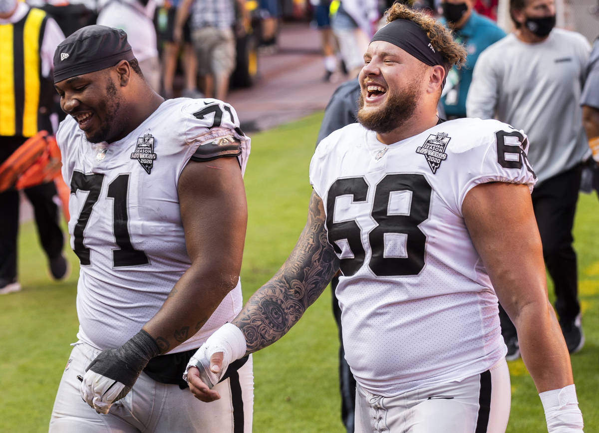 Las Vegas Raiders offensive tackle Denzelle Good (71) and Las Vegas Raiders offensive tackle An ...