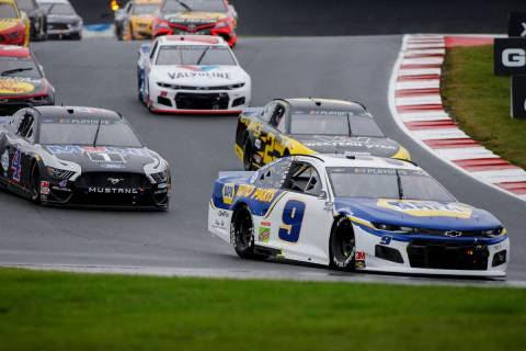 Chase Elliott (9) leads the way out of Turn 7 in a NASCAR Cup Series auto race at Charlotte Mot ...