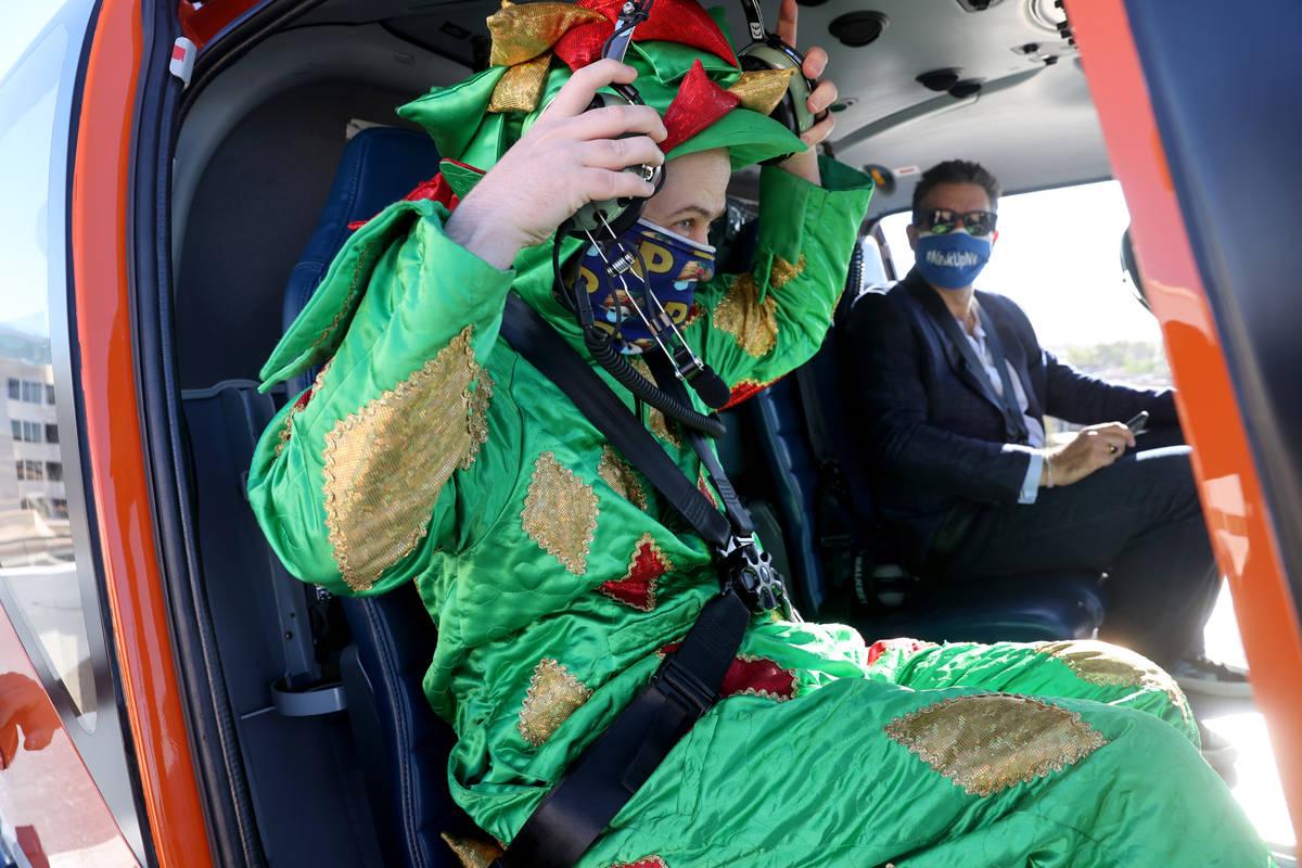 Piff the Magic Dragon and Las Vegas Review-Journal columnist John Katsilometes prepare for a fl ...