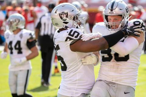 Las Vegas Raiders defensive end Maxx Crosby (98) celebrates with Las Vegas Raiders defensive en ...