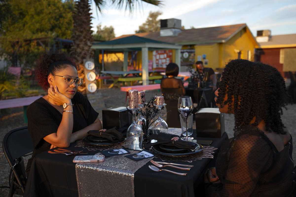 Krystal Derby listens as Najla Grant speaks before dinner at a Noir Culinary Experience event t ...