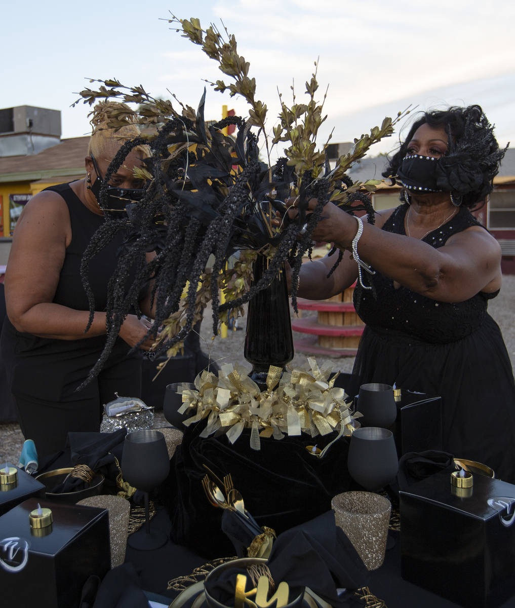 Lois Smith, left, and Verdale Quinney, right, perfect their table's decor before dinner at a No ...