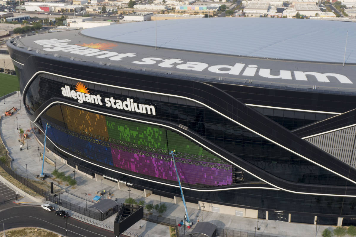A massive 27,600 square foot video board lights up with color on the Interstate 15 facing porti ...