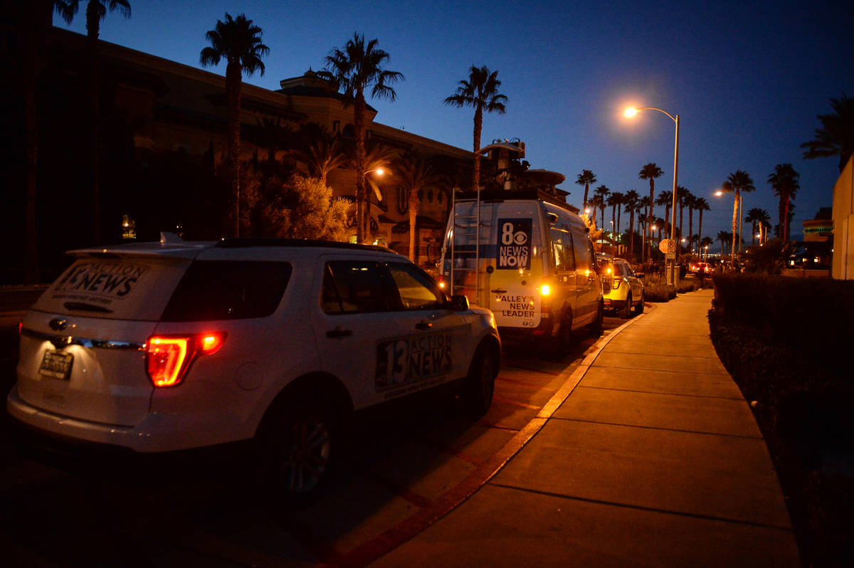 Local news station vans line up after reports of a shooting at Green Valley Ranch casino in Hen ...