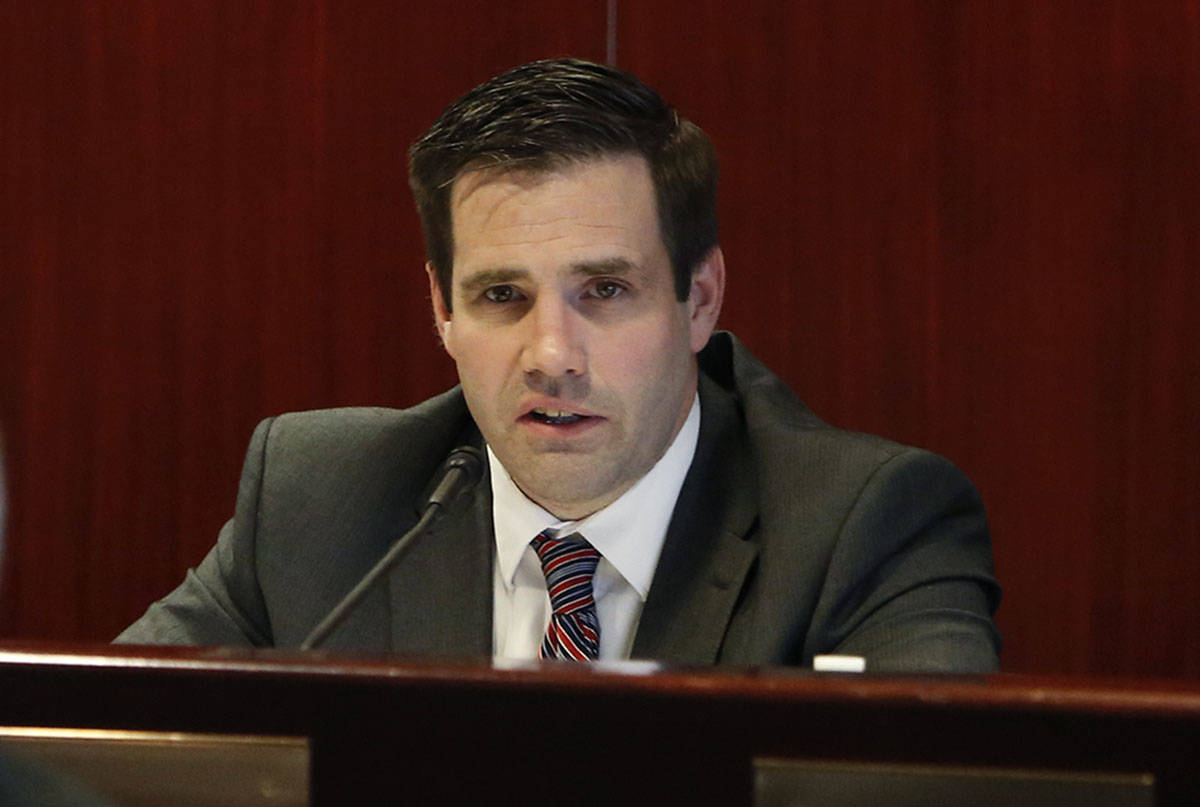 Caleb Cage, the state's COVID-19 response director, speaks at the Grant Sawyer State Office B ...